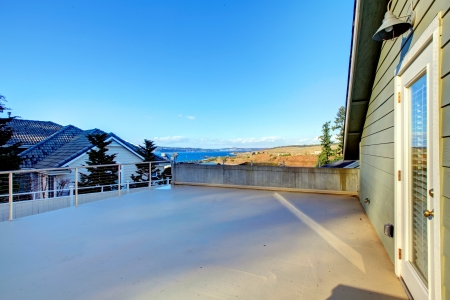 Northwest paneled house with a big back porch and wonderful picturesque view on the bay Stock Photo - 25305896