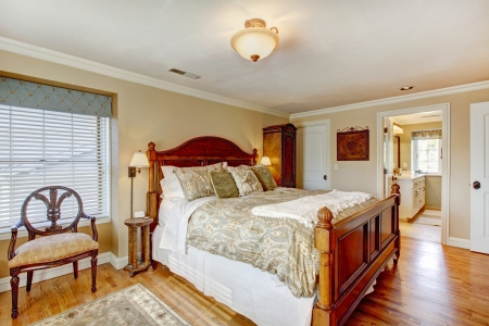 furnished: Large furnished bedroom with rustic antique furniture and hardwood floor Stock Photo