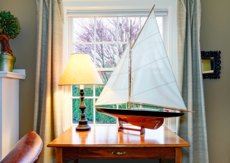 classic living room: Classic living room with a wonderfully matched handicraft soalboat on rustic wooden table