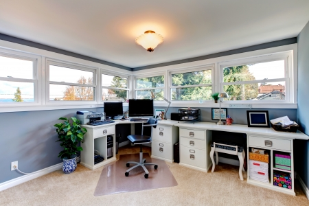 office furniture: Bright office room with light tones furniture and beige carpet floor