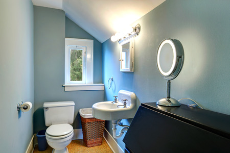 vaulted: Small bathroom with blue wall, white vaulted ceiling and yellow floor Stock Photo