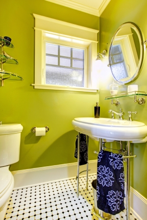 Small bathroom with bright neon green wall and designed tile floor photo