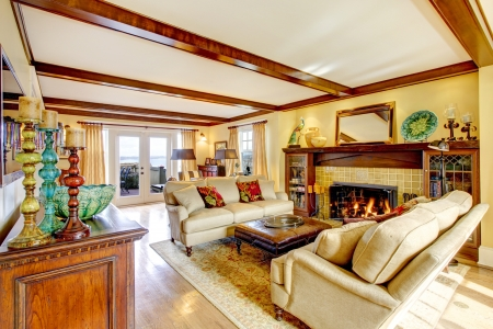 brigth: Brigth living room with rustic furniture, ceiling beams, fireplace and walkout deck Stock Photo