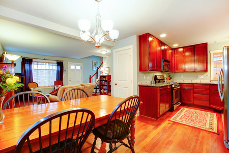 Well matched blue living room with brown tones kitchen room and dining area photo