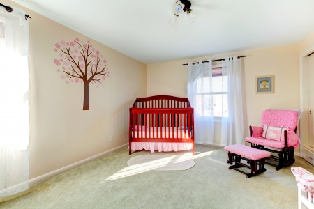 Bright neutral color baby room with ivory decorated wall photo