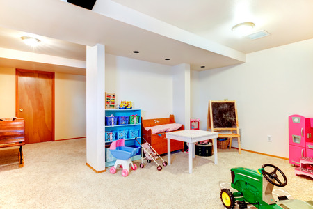 storage unit: Well designed bright kids toom with toys, chalkboard, table, storage unit