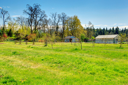 Picturesque farm with greenhouse and shed overlooking beautiful landscape Stock Photo - 28688389