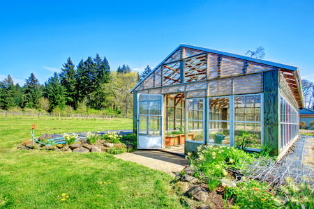 Picturesque farm with greenhouse and shed overlooking beautiful landscape Stock Photo - 28688319