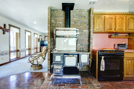 Great design idea for farmhouse kitchen room. Brick wall well matched with antique stove