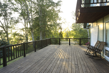 Large deck with chairs overlooking summer countryside forest Stock Photo - 25561931