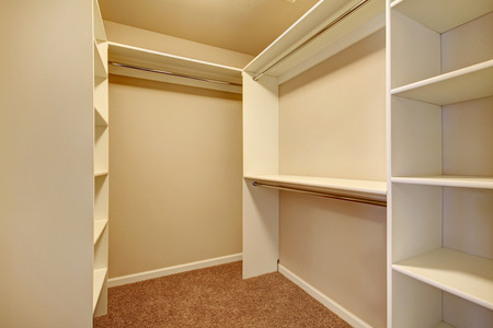 nobody real: Ivory and beige walk-in closet with carpet floor