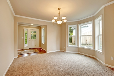 Beautiful empty room with designed angle wall, carpet floor photo