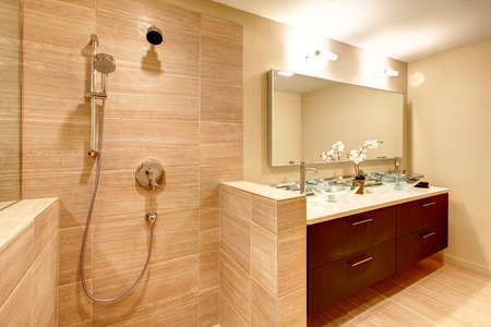 Elegant beige bathroom with shower Stock Photo
