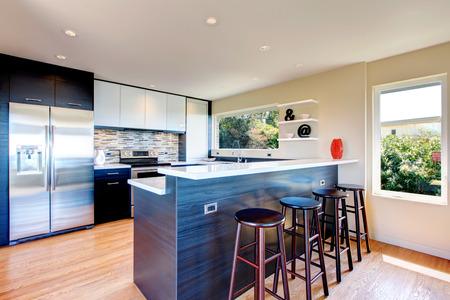 Elegant kitchen room with black wood storage combination accopmlished with stoned backsplash and decorative vase and wall shelf