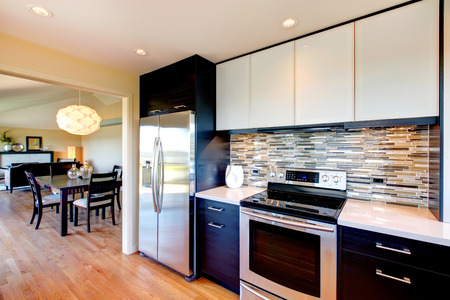 home appliances: Black and white modern kitchen room with dining area