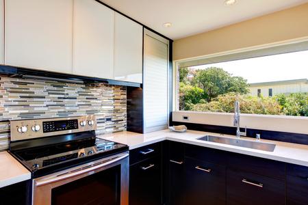 Black and white modern kitchen room with multi color backsplash Stock Photo