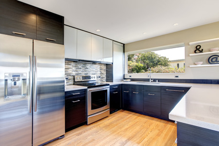 appliances: Kitchen room with black storage combination