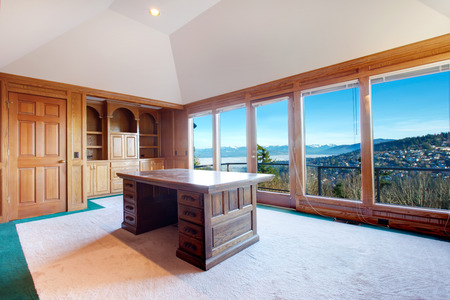 wood ceiling: Luxury office room with rich wood furniture, carpet floor, cathedral ceiling and amazing floor-to-ceiling window with impressive view on mountain landscape