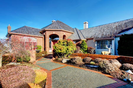 impressive: Impressive luxury house with colomn porch, tile roof, stoned walkway Stock Photo