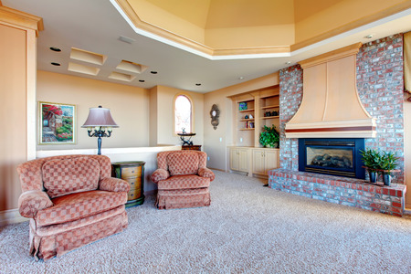 Cathedral ceiling bright luxury family room with antique chais photo