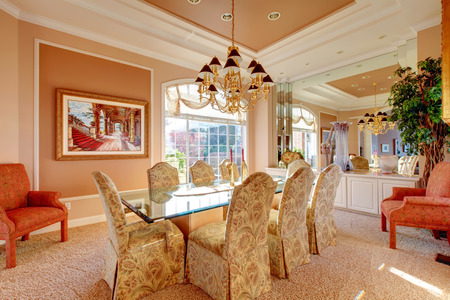 dining table and chairs: Rich dining room with wonderful dining table set, antique chairs and decorative tree