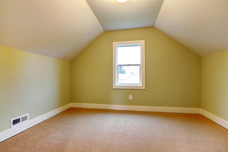 vaulted: Empty room with beige carpet floor, yellow bright walls and white vaulted ceiling