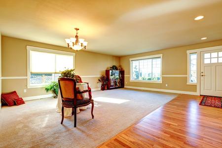 Hardwood floor open hallway extended to carpet floor living room. photo