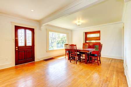 dining table and chairs: Bright big open living and dining room with hardwood floor