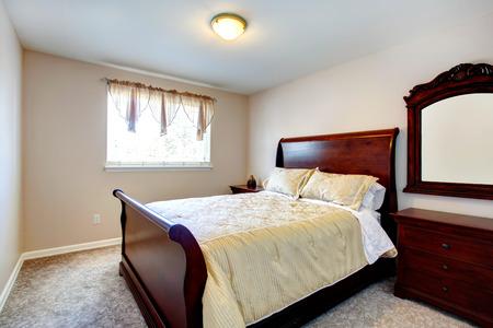 queen bed: Cozy bedroom with beige carpet floor, carved wood mirror, cherry queen size bed and nightstand