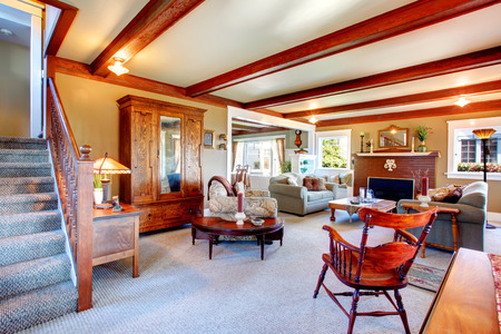 Big living room with grey carpet floor ceiling beams stoned fireplace. Stock Photo & Big Living Room With Grey Carpet Floor Ceiling Beams Stoned ...
