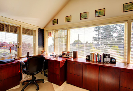 vaulted: Vaulted ceiling office room with carpet floor, bright cherry cabinets, black whirpool chair