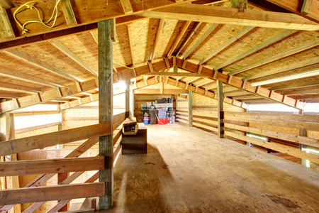 Wooden interior of horse stable photo