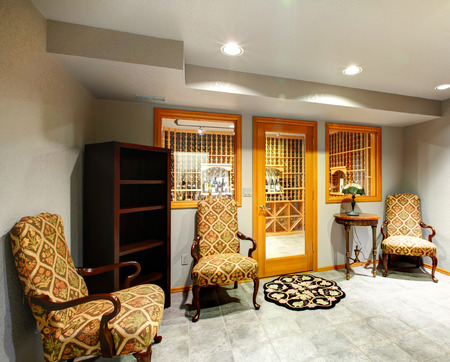 Small hallway with antique style chairs and table. Entrance to wine cellar photo