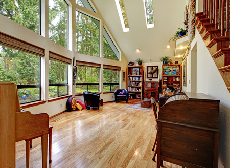 vaulted: Big living room with high vaulted ceiling, glass wall and hardwood floor
