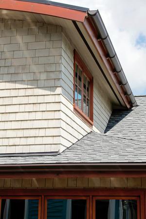 tile cladding: Beach siding house with tile roof. Exterior design idea. Stock Photo