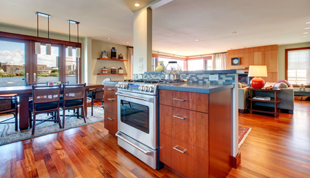 Hardwood floor bright kitchen with dining area and living room. photo