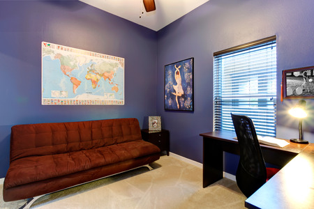 Lilac office room with window, carpet floor. Furnished with brown sofa, wooden desk and whirlpool chair Stock Photo - 26038090