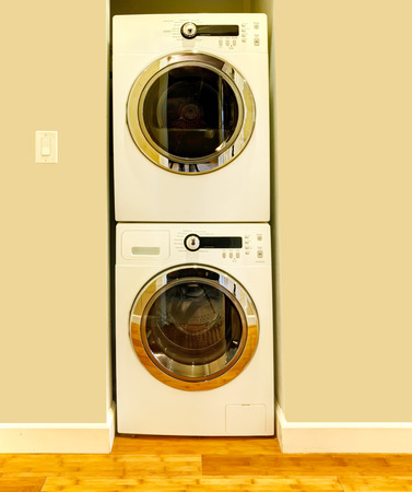 niche: Niche in the ivory wall for washer and dryer. Great design idea when there is no laundry room