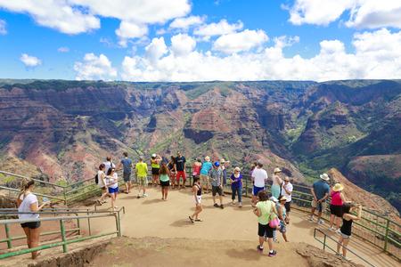 memorable: Tourists enjoying picturesque view of Waimea Canyon on observation deck  Hawaiian islands  Editorial