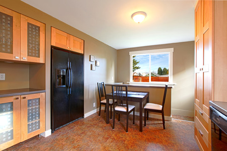 Modern maple kitchen with black appliances Stock Photo
