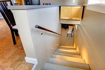 Staircase to the basement with lights on Stock Photo - 26094572