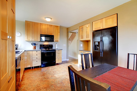 kitchen cabinets: Maple cabinets in brown large kitchen