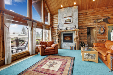 Large beautiful living room in log cabin house  Stock Photo