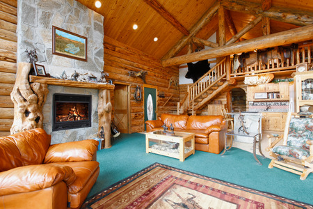 Large beautiful living room in log cabin house photo
