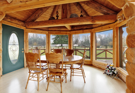 wooden ceiling: Bright dining room in log cabin house