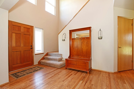 cherry hardwood: Beautiful entrance hall with a hardwood floor and cabinet