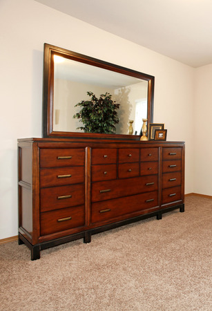 drawers: Beautiful cherry dresser with drawers and mirror.