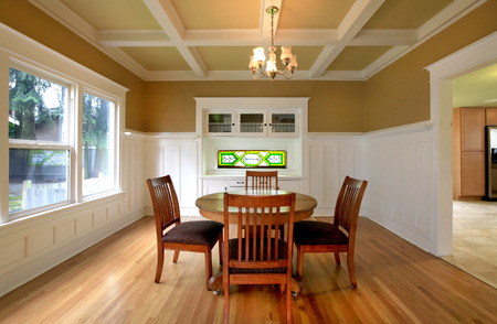 Stock Photo   White And Mustard Dining Room With A Coffered Ceiling And  Hardwood Floor. Built In Antique White Cabinet