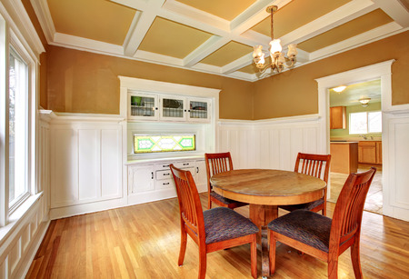 White And Mustard Dining Room With A Coffered Ceiling And Hardwood.. Stock  Photo, Picture And Royalty Free Image. Image 26301896.