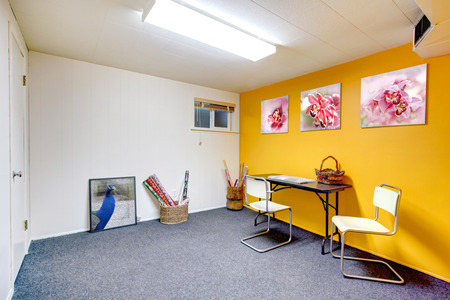 White and yellow art room without window. Blue carpet floor Stock Photo - 26450973